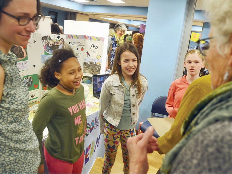 Students learn by teaching on the exhibit floor