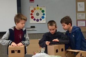 Students explore energy efficiency in model houses. They encourage adults to take action to make their own houses more efficient.